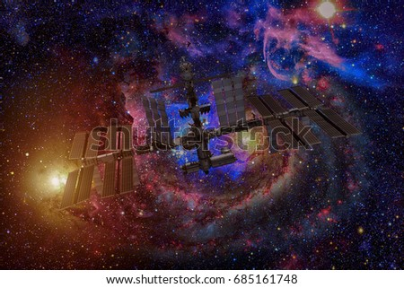 International Space Station over spiral galaxy Earth. Elements of this image furnished by NASA.