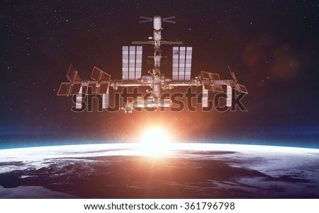 International Space Station over the planet Earth. Elements of this image furnished by NASA - stock photo
