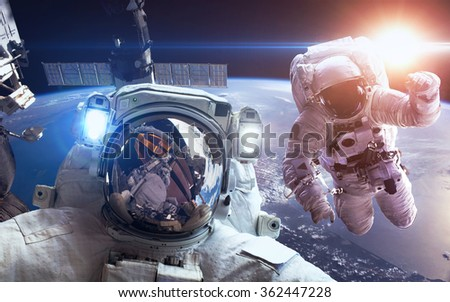 International Space Station with astronauts over the planet Earth. Elements of this image furnished by NASA - stock photo