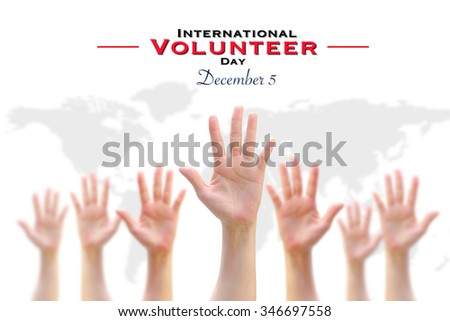 International Volunteer Day for Economic and Social Development on December 5: Many people blur hands raising upward on white background for vote, volunteering, participation, concept/ campaign  - stock photo