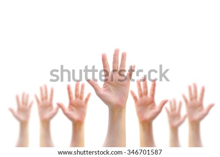 International Volunteer Day for Economic and Social Development on December 5: Many people blur hands raising up upward on white background showing vote, volunteering, participation concept/ campaign