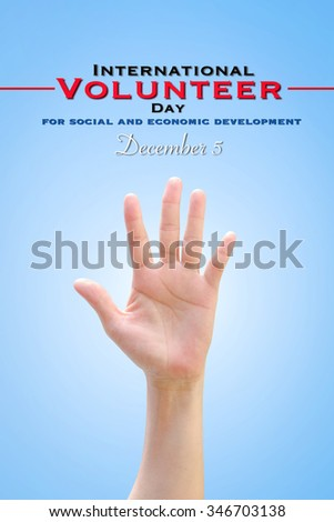 International Volunteer Day for Economic and Social Development on December 5: Woman human hand raising upward on blue sky background showing vote, volunteering, participation, concept/ campaign  - stock photo