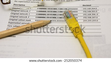Internet and intranet network scheme: Network map, Ethernet plug, wooden pencil and glasses - stock photo