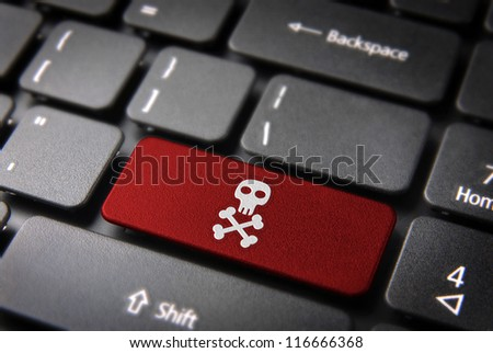 Internet business security concept: red key with skull icon on laptop keyboard. Included clipping path, so you can easily edit it. - stock photo