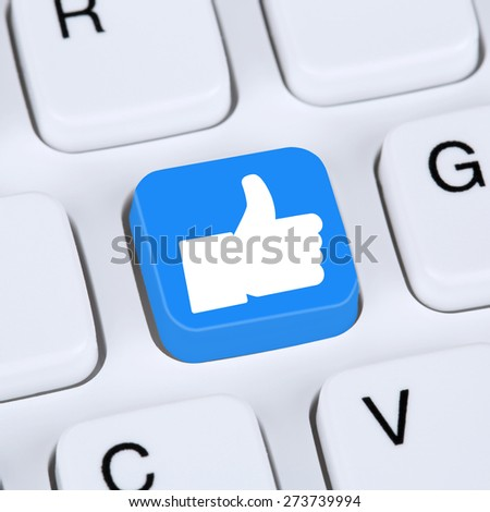 Internet concept like button icon symbol thumb up social media or network on computer keyboard - stock photo