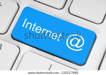 Internet concept on blue button of the keyboard - stock photo