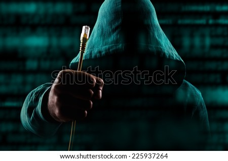Internet connection lost.Man holding unplugged cable  - stock photo