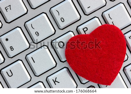 Internet dating concept. Red heart on the computer keyboard. - stock photo