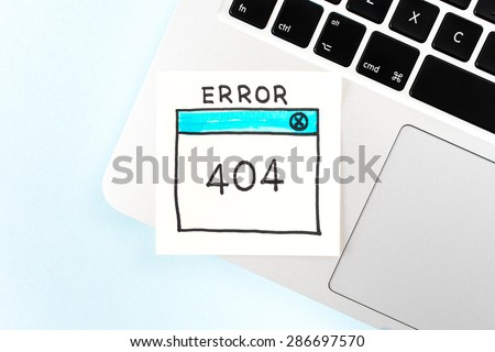"""Internet Error 404 """"Page Not Found"""" on notebook and blue background. - stock photo"""