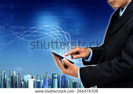 Internet for business conceptual image. Businessman using internet information technology to communicate, share and access global information. - stock photo
