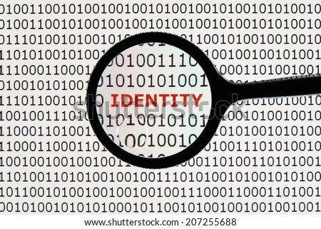 Internet identity theft on a digital tablet with magnifying glass concept for online digital crime - stock photo