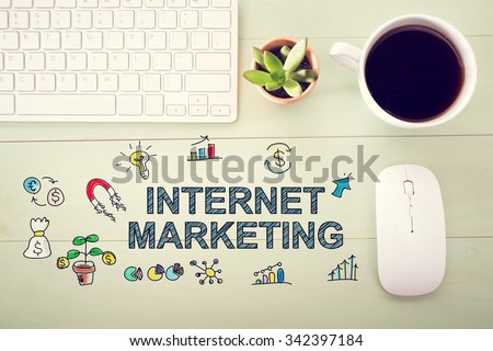 Internet Marketing concept with workstation on a light green wooden desk - stock photo