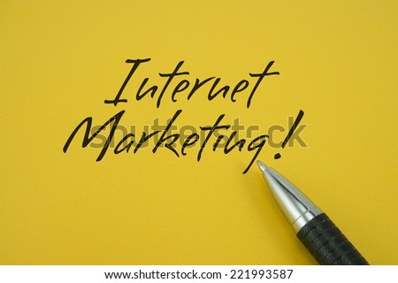 Internet Marketing! note with pen on yellow background