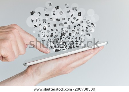 Internet of things (IoT) and smart machines concept with hands holding tablet - stock photo