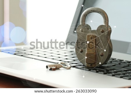 Internet security concept-old  padlock and key on laptop computer keyboard