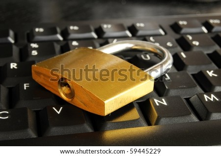 internet security concept with padlock on black keyboard - stock photo