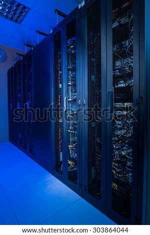 Internet server room in datacenter - stock photo