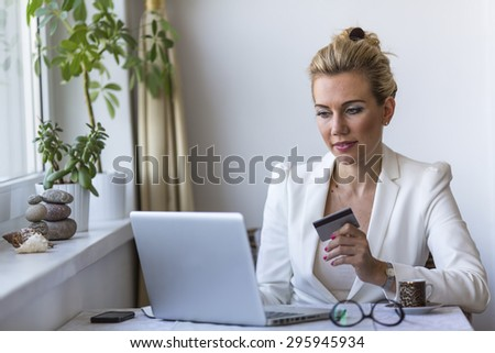 Internet shopping. Woman shopping online with credit card and laptop. - stock photo