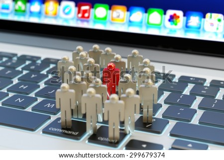 Internet social media network community and business marketing and targeting concept, group of people and one man selected on computer laptop keyboard - stock photo