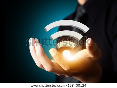 Internet technology and networking concept, Businessman hand with wifi on tablet virtual screen - stock photo