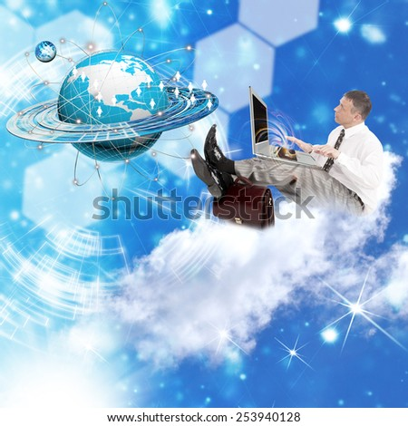 Internet technology.Businessman with laptop on clouds.E-business - stock photo