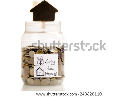 Interpretation of home financing and saving concept by using coin in the jar with home wooden sign - stock photo