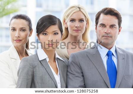 Interracial Caucasian European and Chineses Asian group of business men & women, businessmen and businesswomen team - stock photo