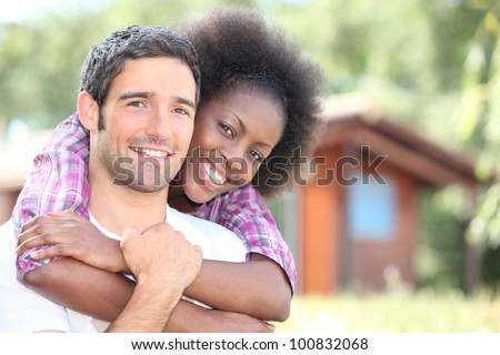 interracial couple embracing - stock photo
