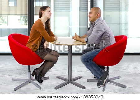 interracial couple on a casual coffeeshop date - stock photo