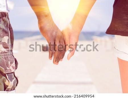interracial couple taking a walk - stock photo