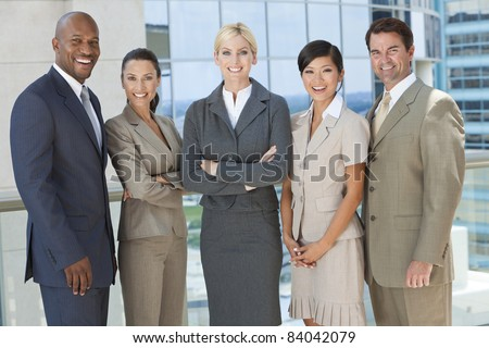 Interracial group of business men & women, businessmen and businesswomen team