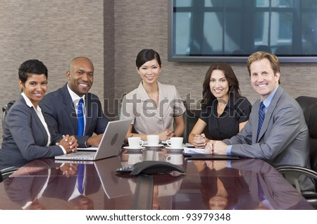 Interracial group of business men & women, businessmen and businesswomen team meeting in boardroom - stock photo