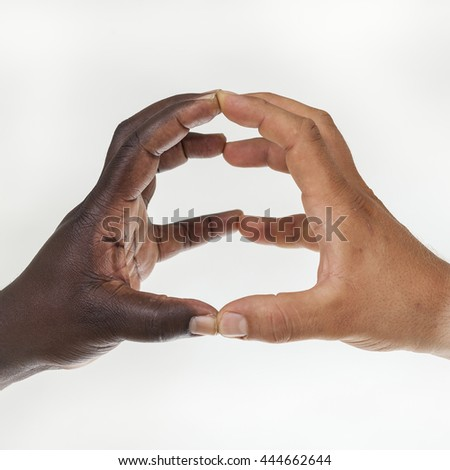 Interracial hands with touching fingers : union and cooperation concept. White background - stock photo
