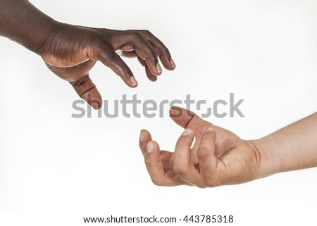 Interracial helping hands: humanity and brotherhood concept. White background - stock photo