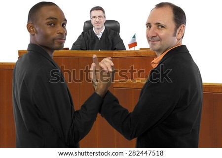 Interracial male gay couple celebrating legalization of same-sex marriage in Ireland.  The court bench has a judge and an Irish flag. - stock photo