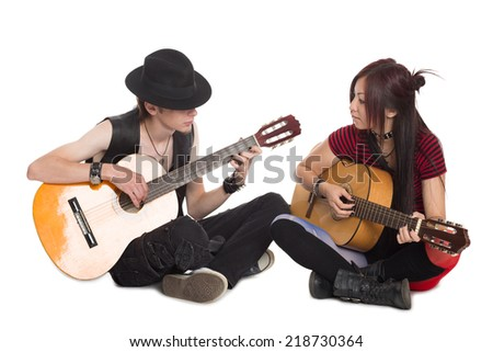 Interracial young couple music, isolated on white. Asian woman and Caucasian man. - stock photo