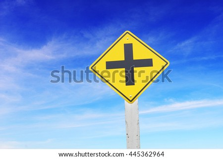 Intersection ahead, traffic sign say intersection ahead, with blue sky and white cloud background. Concept in making choices, or ways to go.  - stock photo