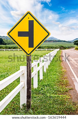 Intersection Caution of Traffic Sign in Countryside - stock photo
