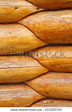 intersection, round wood beams on exterior wall of a lodge - stock photo
