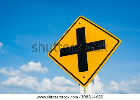 Intersection traffic sign post, over blue sky - stock photo