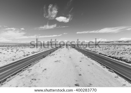 Interstate 15 between Los Angeles and Las Vegas in black and white. - stock photo