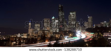 Interstate 5 cuts through Downtown Seattle after the sun sets - stock photo