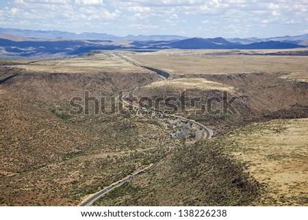 Interstate 17 cutting through Mesas and Mountains north of Phoenix, Arizona - stock photo