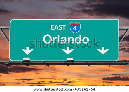 Interstate 4 east to Orlando highway sign with sunrise sky. - stock photo