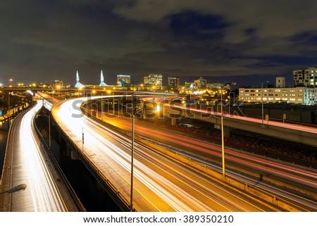 Interstate Freeway Light Trails and Northeast Portland Skyline at Night - stock photo