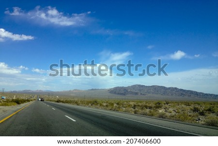 Interstate 10 in Chiriaco mountains summit running down to next mountains, CA - stock photo