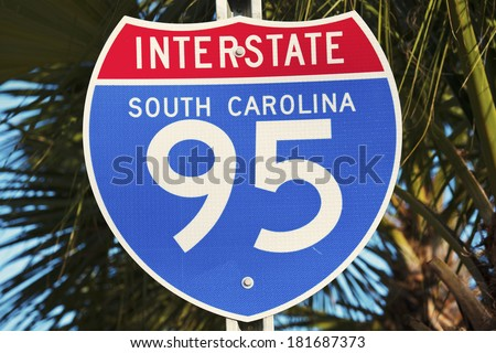 Interstate 95 in South Carolina sign seen against palm tree