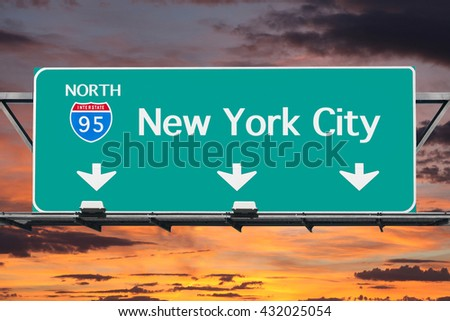 Interstate 95 to New York City Highway Sign with Sunrise Sky - stock photo