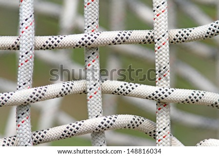Intertwined textured nautical coloured woven rope  - stock photo