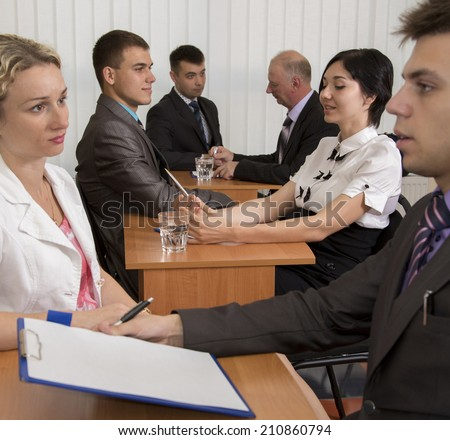 Interview. Many business people are passing interview at the office - stock photo